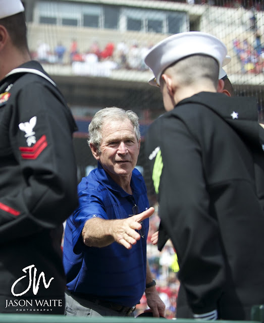 President George W. Bush shakes hands with military