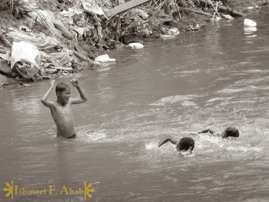Swimming children in Mae Sai River, Mae Sai, Thailand
