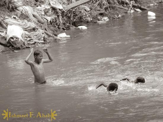 Swimming children in Mae Sai River, Mae Sai, Thailand