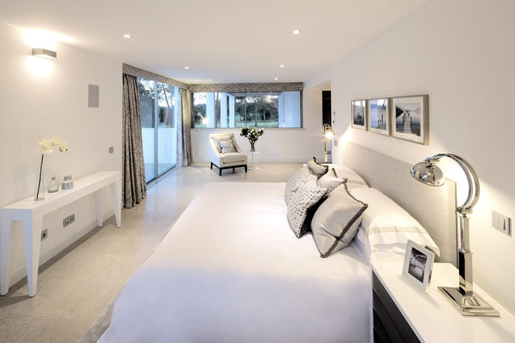 White bedroom in Simple modern home in Portugal