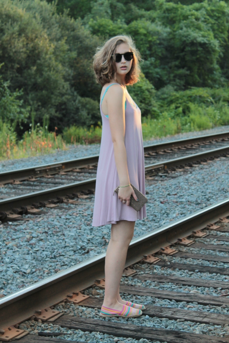 Slouchy dusty pink Brandy Melville dress, Aerie bralette, black and gold sunglasses