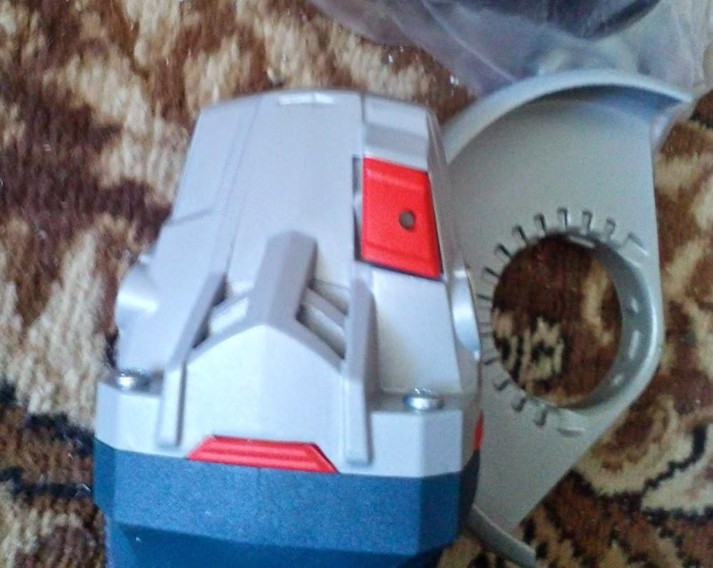 УШМ Bosch GWS 12-125 CIE кнопка блокировки шпинделя