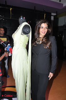 Raveena Tandon Pictures in Black Stylish Dress at Eden with Love Courture Line Launch  0005