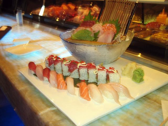 A plate full of sushi and sashimi from Oishii Asian Fusion.