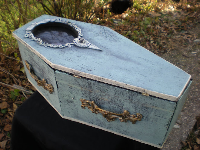 Coffin display case with creepy green glow lights