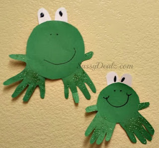 two frogs made out of paper and handprints