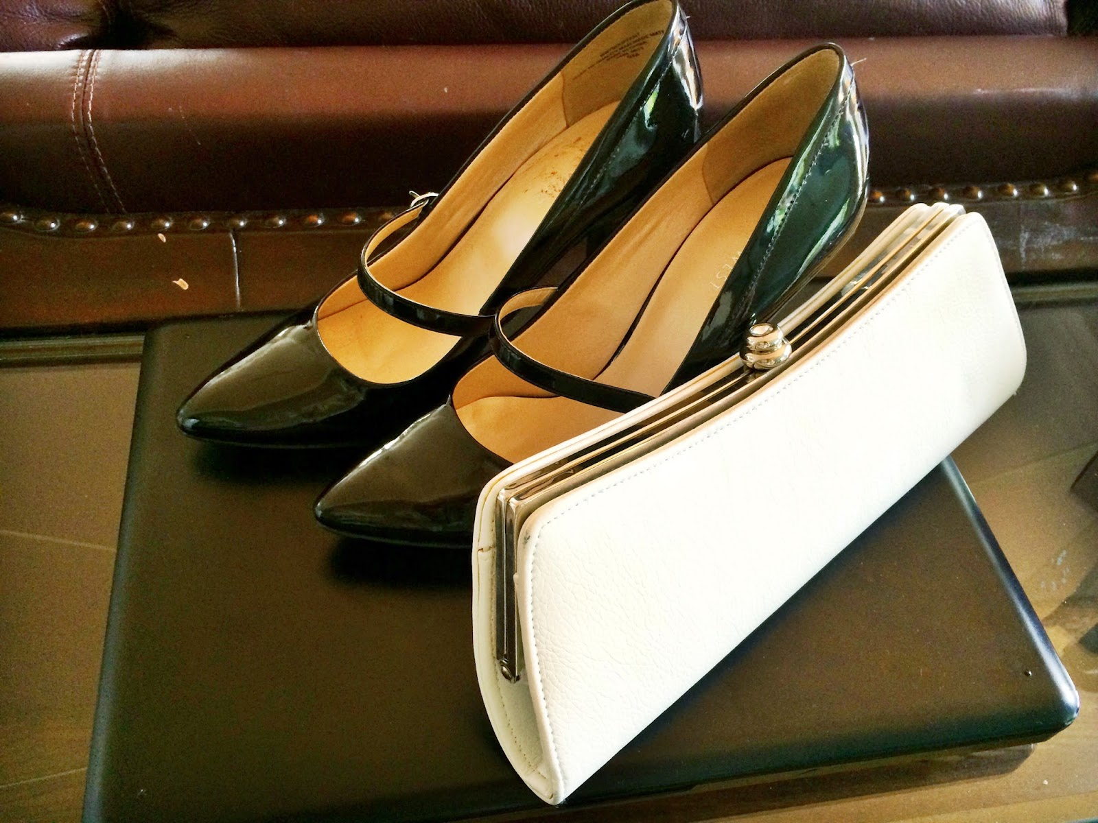 Black Patent Leather Mary Janes and White Mod Clutch   all dressed up with nothing to drink...
