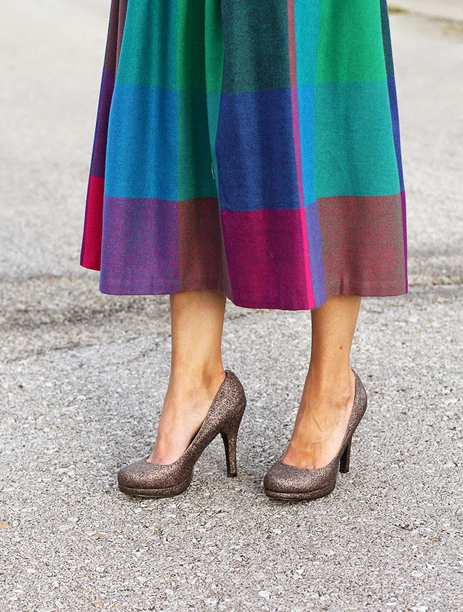 Bright, bold plaid skirt and glitter heels