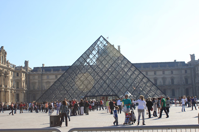 A huge crowd of visitors flock to the Lourve Museum since early in the morning in Paris, France