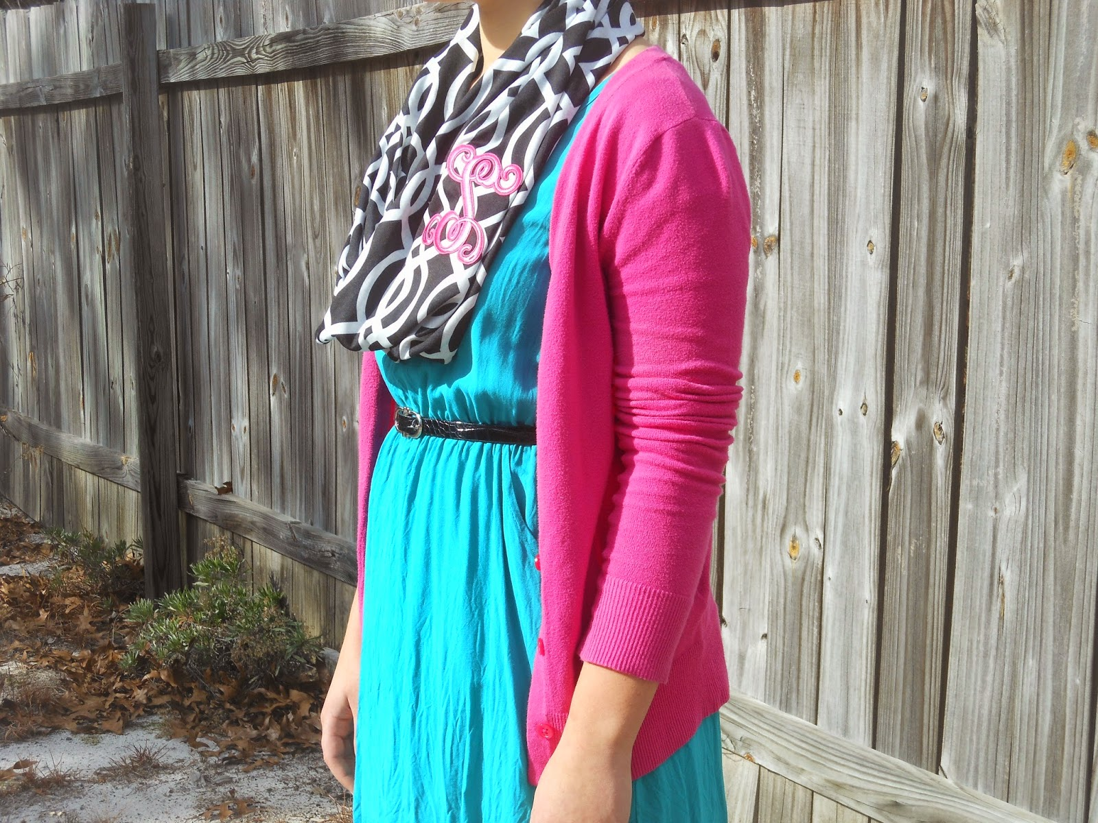 How to Wear a Dress in Winter || 04. Teal tunic dress, grey leggings, pink cardigan, black ankle boots, black and white monogrammed scarf, black belt.