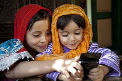 header:two girl with mobile: Intelligent Computing