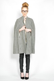 Vintage 1960's black and white houndstooth cape with zip front closure.