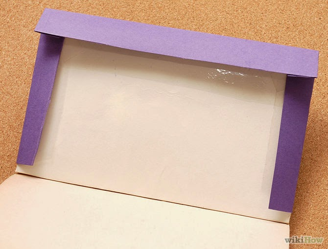 How to Cover a Book With a Paper Folder step 2