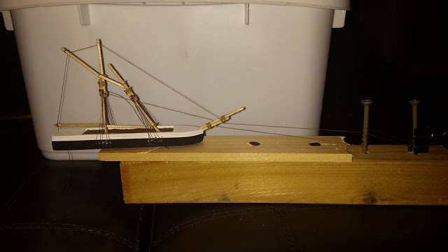 ship model on rigging stand