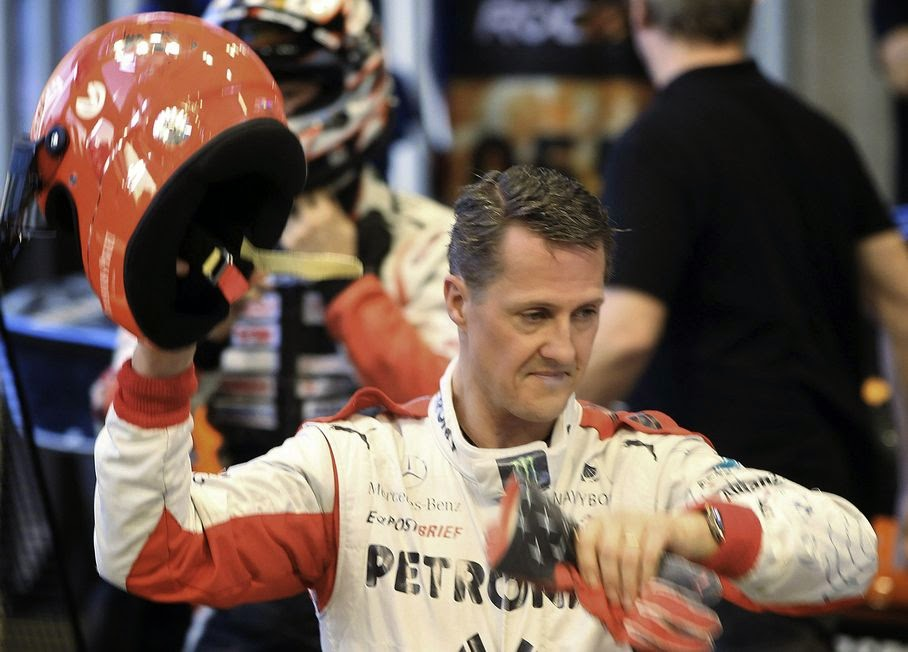"This is a Sunday, Dec. 16, 2012. file photo of Michael Schumacher of Germany as he holds a helmet after a test drive prior to the Race Of Champions at Rajamangala national stadium in Bangkok, Thailand. Schumacher's manager says the Formula One great is no longer in a coma and has left a French hospital where he had been receiving treatment since a skiing accident in December. Manager Sabine Kehm says in a statement Monday, June 16, 2014, that Schumacher has left the hospital in Grenoble ""to continue his long phase of rehabilitation."" The statement did not say where the seven-time F1 champion was taken or give any details of his condition."