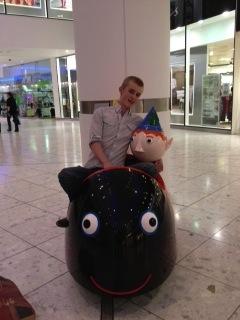 teen on child's ride
