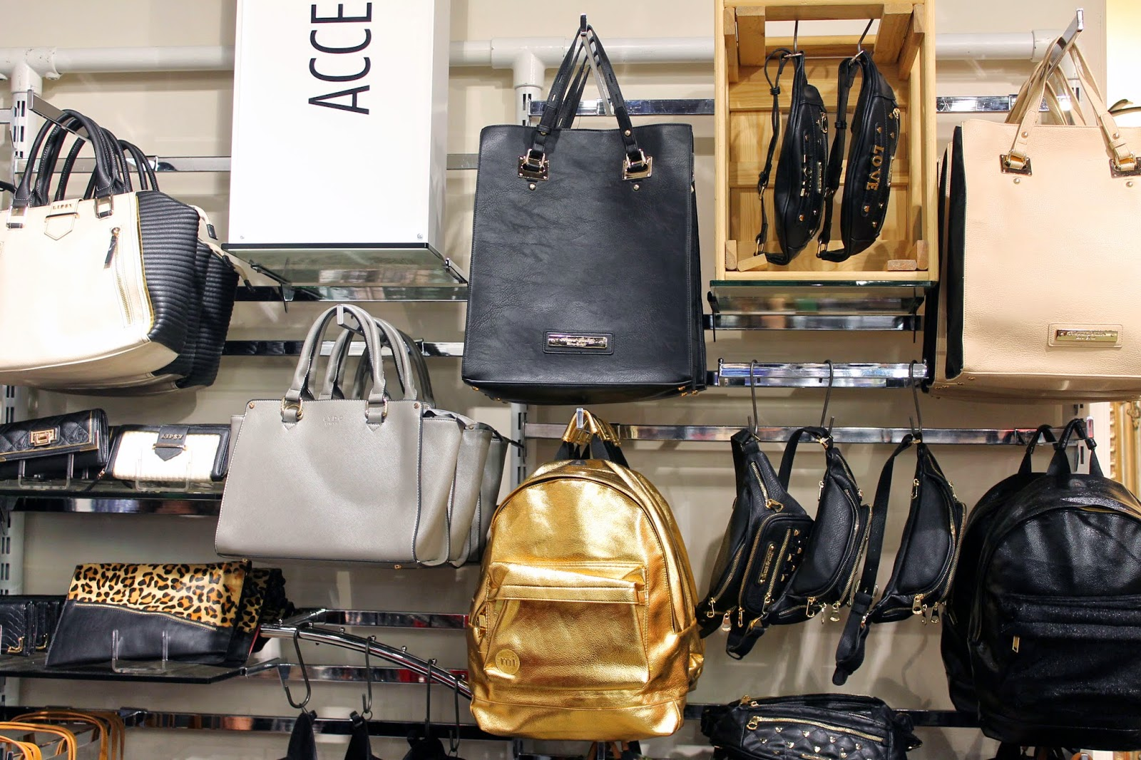 BANK fashion warrington store accessories visual merchandising black and gold