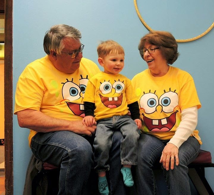 Carter and great grandparents all wearing Sponge Bob t-shirts.