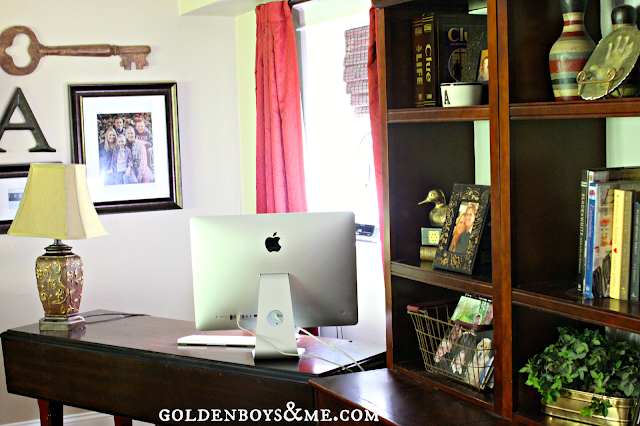 bookshelves and gallery wall near family room desk area, part of Fall Home Tour via www.goldenboysandme.com