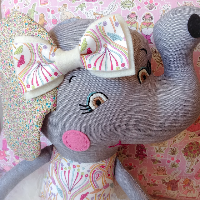 Hand-embroidered face of Liberty Elephant Doll