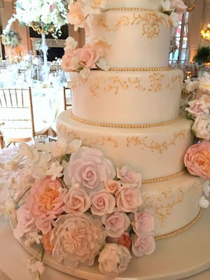 white and gold wedding cake with handmade sugar flowers