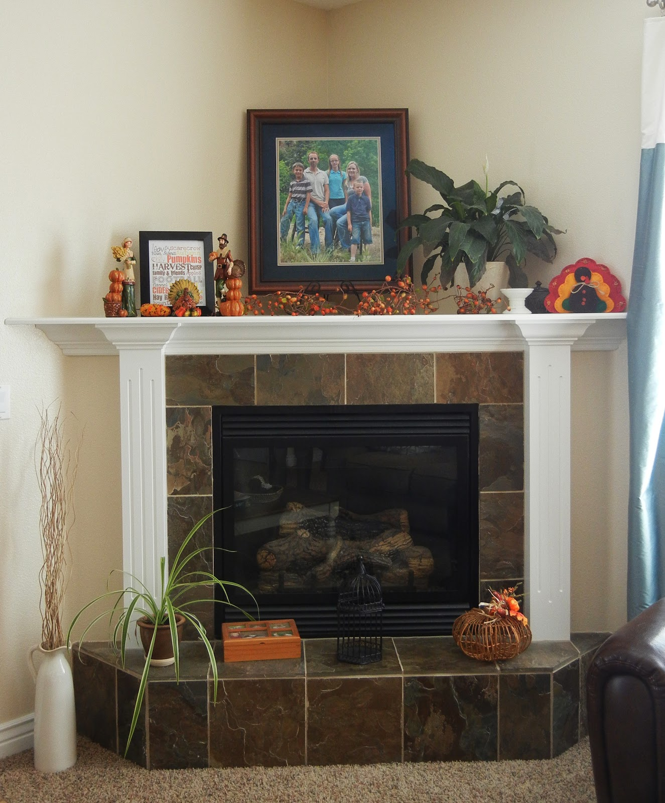 vanessa 39 s fireplace with its tile base and deep corner top ledge is