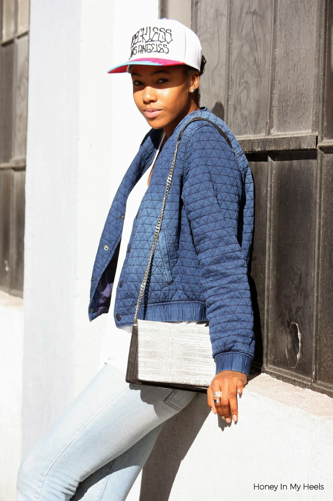 Wearing H&M quilted denim bomber & crossbody bag Reiss oversized tank Young & Reckless cap