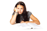Young Woman Bored with Studying