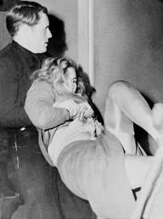 Actress Frances Farmer being dragged against her will into psychiatric care