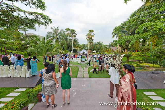 outdoor wedding crowd gathering to witness solemnization