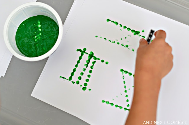 Learning about Roman numerals by stamping with LEGO - fun math art for kids from And Next Comes L