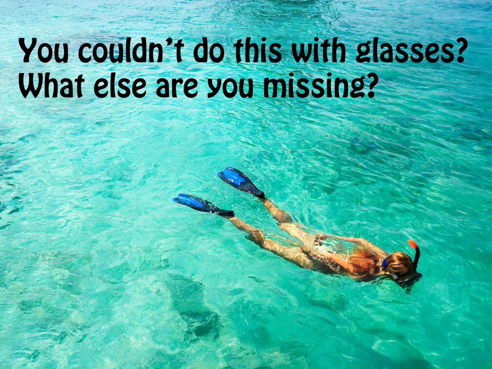 "<img alt=""woman snorkeling in beautiful green water after LASIK"""