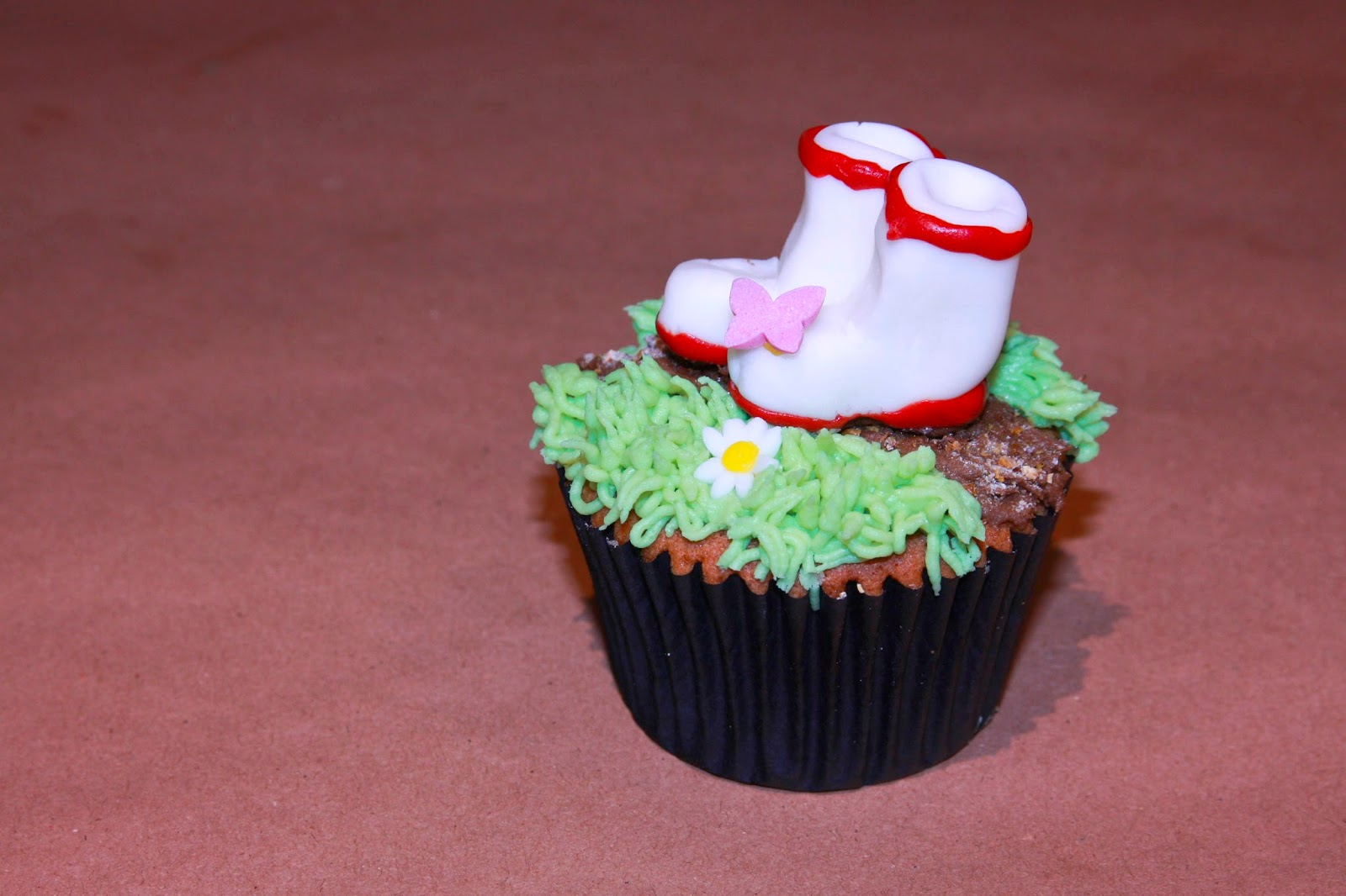 Earl Grey cupcake decorated with a garden path and wellies