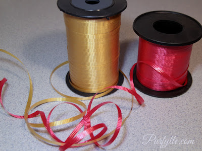 Curling ribbon can be used for a lot more then just wrapping presents. Perfect for a crochet bauble garland.