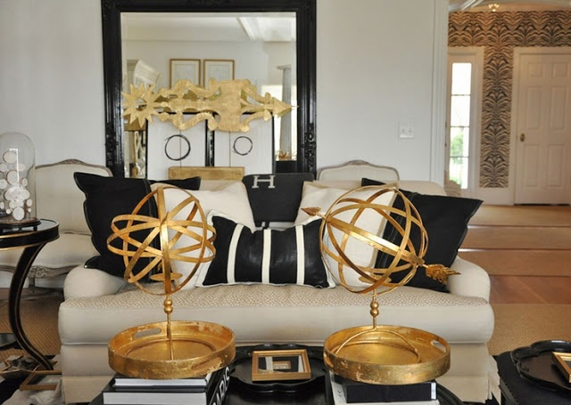 black and white design living room with gold accents