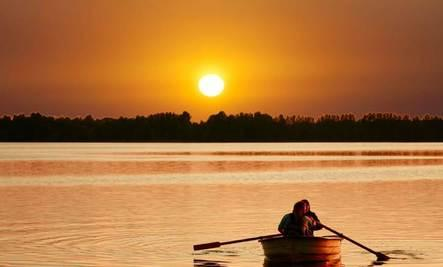 Beautiful Urge - man woman couple sailing on boat at sunset