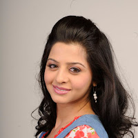 suave and scenic Vedhika cute pics
