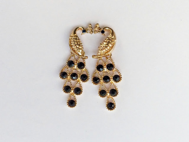 Black stones yellow metal peacock earrings