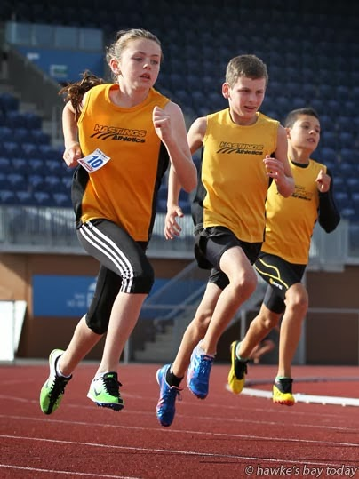 L-R: Libby Charlton, 10, Mitchell Snell, 11, Wesley Akeripa, 11, athletes from the Hastings Athletics Club, pictured warming up before training at the Hawke's Bay Regional Sports Park, Hastings, have been selected in the Trans Tasman team photograph