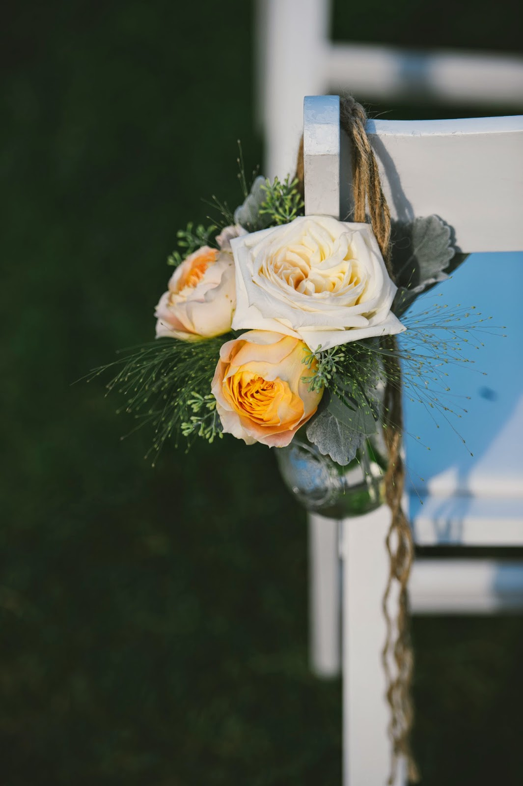 les fleurs : outdoor late summer wedding : barn at gibbet hill : mason jar hung from the chairs with jute twine, caramel garden roses, ivory garden roses, dusty miller and wispy grasses