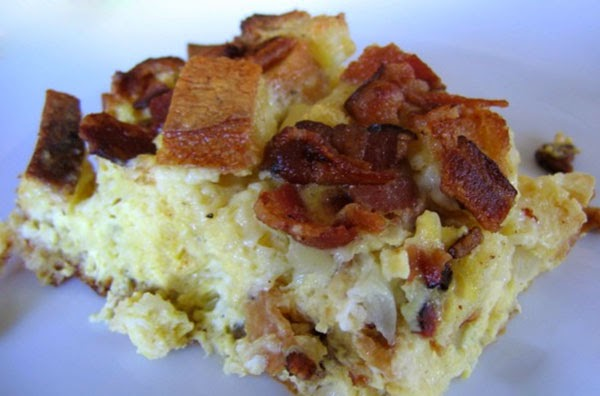 Make Ahead New Year Hangover Breakfast: A breakfast casserole of eggs, bread, sausages, onion and bacon that can be prepared the evening before and which is ideal for anyone with a New Year reveller's hangover