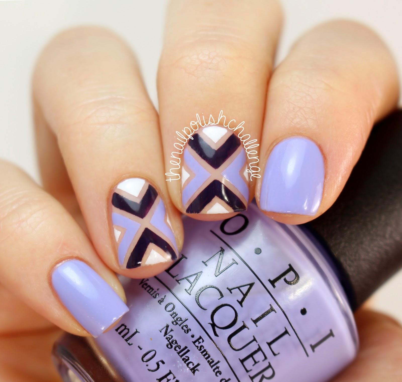 Kelli marissa purple opi striping tape nail art i started with a base of opi youre such a budapest on my outer two fingers and opi glints of glinda on my two middle nails then i taped off sections prinsesfo Choice Image