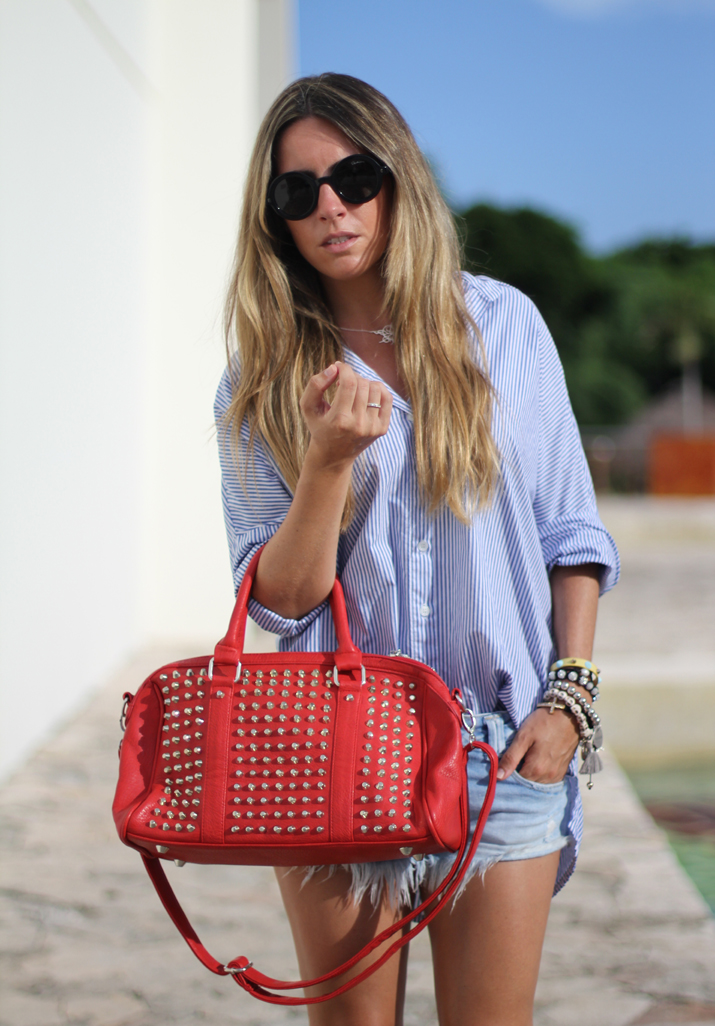 Outfit with boyfriend shirt, denim shorts and studded bag