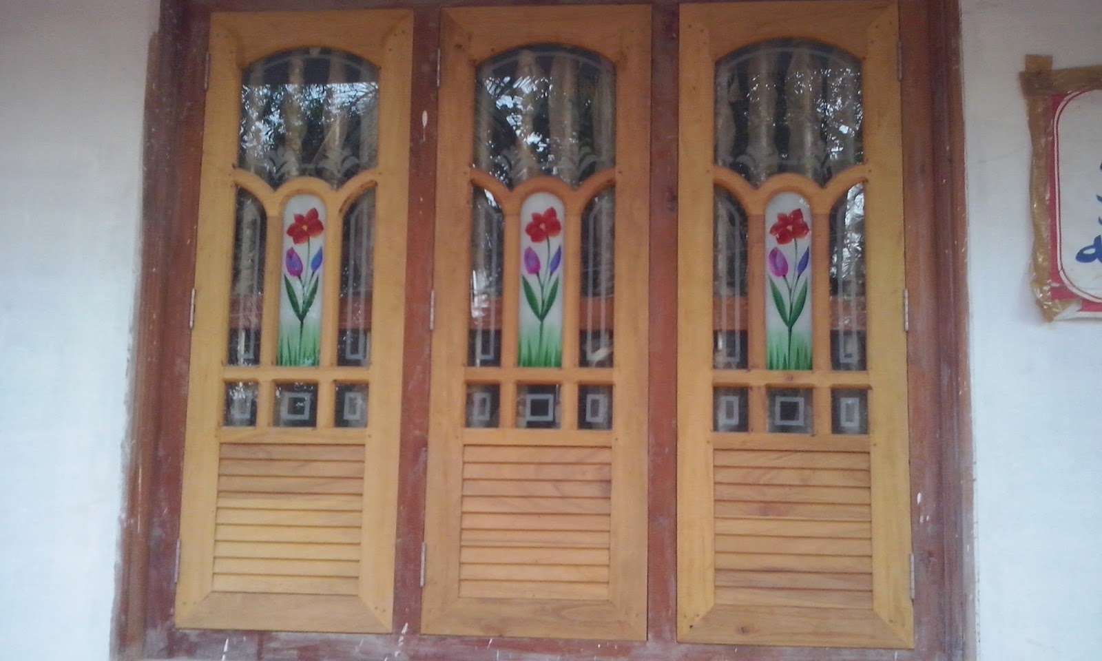 Kerala style carpenter works and designs wooden window for Window glass design images