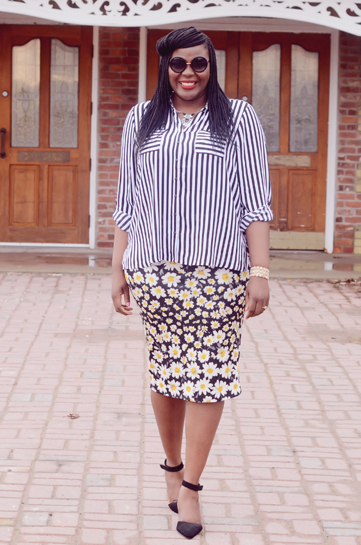 plus size fashion blogger wearing a floral skirt and stripe shirt.
