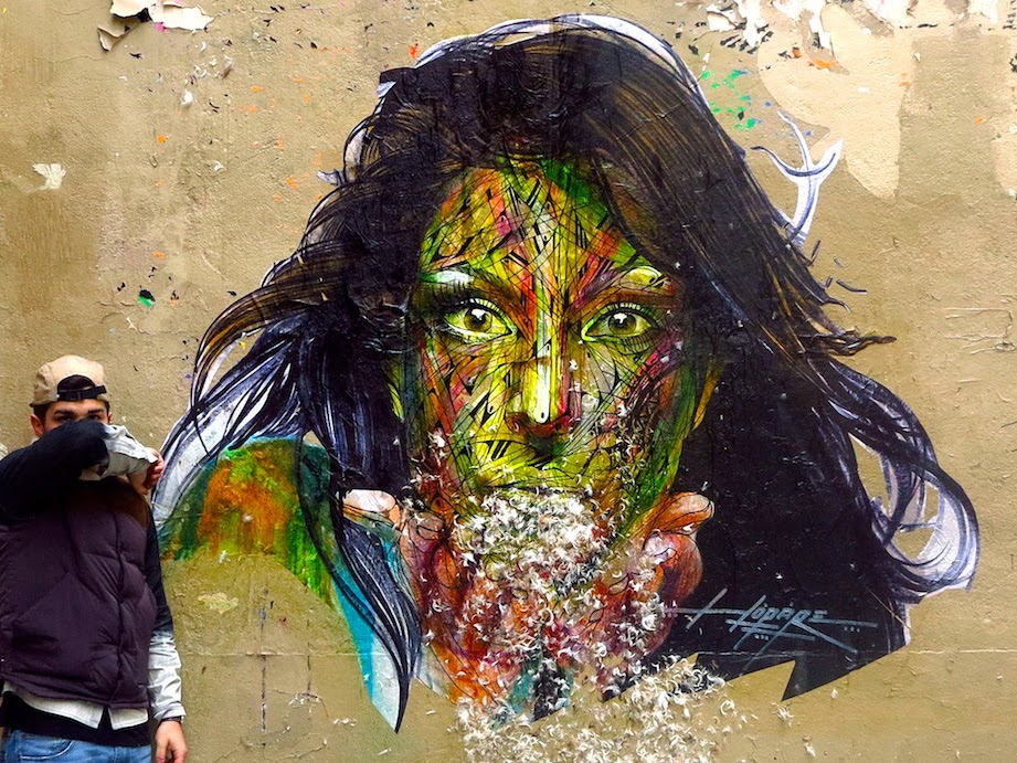 French Street Artist Hopare has been busy in Paris, France with this colourful hand-painted paster. 1