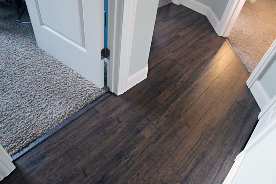 Iheart organizing do it yourself floating laminate floor installation for Installing laminate flooring in bathroom
