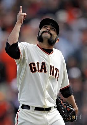 an Francisco Giants' Sergio Romo walks off the field during his MLB National League baseball game against the St. Louis Cardinals in San Francisco, California, April 8, 2011.   REUTERS/Beck Diefenbach