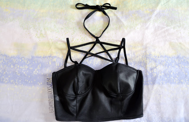 Brandedkitty Shop sells this black strappy pentagram cropped bralet top for $43, featuring a halter neckline and adjustable shoulder straps.