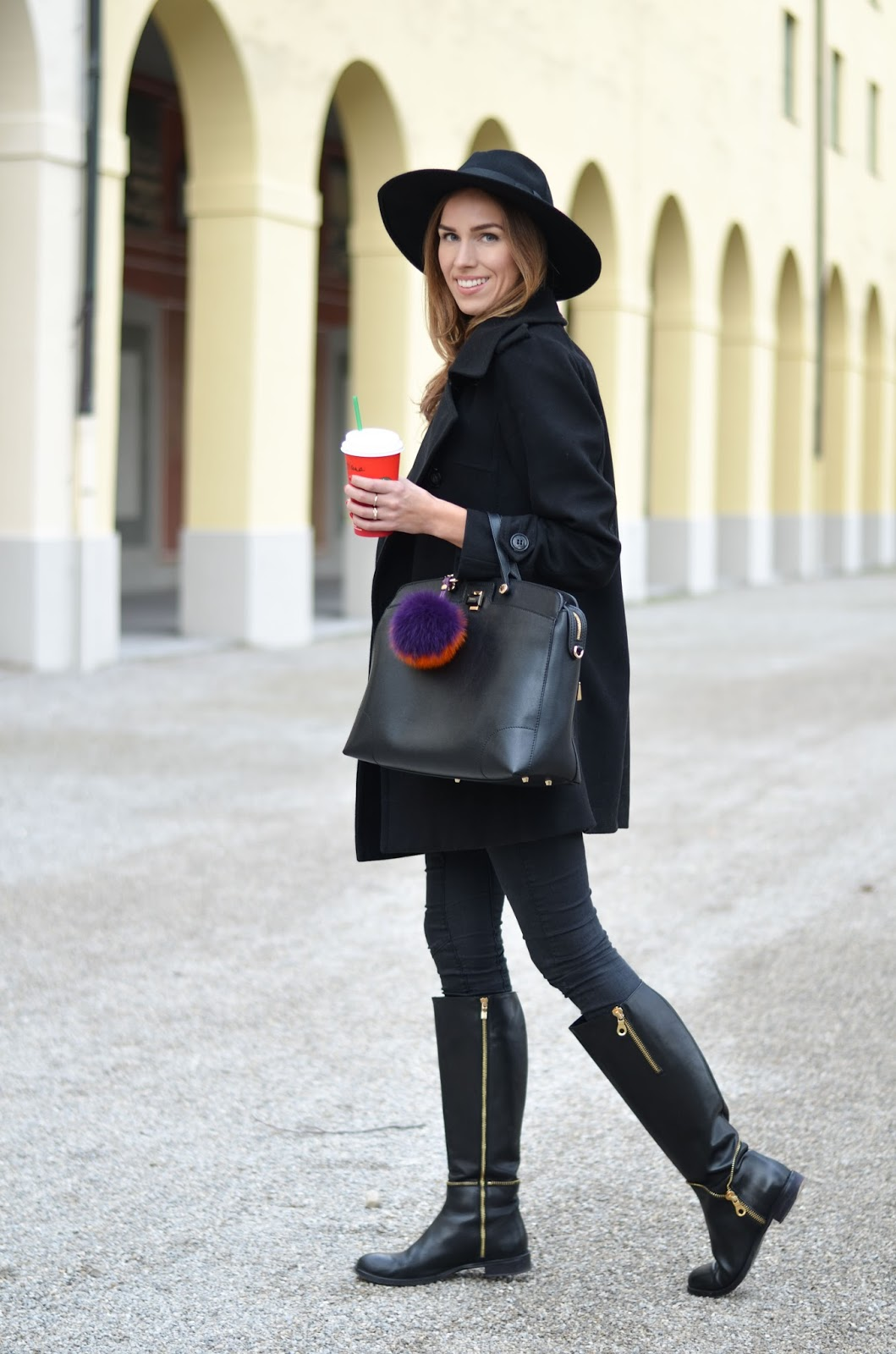 kristjaana mere all black outfit peacoat fedora skinny jeans knee boots winter style